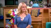 Melissa Rauch has no shortage of cardigans on 'The Big Bang Theory,' covering her curves in this cropped blue sweater.