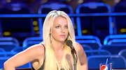 Britney Spears' oversize hoops added impact to her simple top.