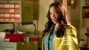 Golden Brooks took her colorful ensemble to the next level with a prettily-printed blouse.