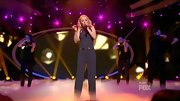 Disco inferno! Hollie Cavanagh hit the 'AI' stage in a retro black jumpsuit.