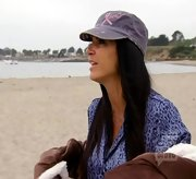 Teresa Giudice hit the beach in a distressed cap with a breast cancer logo.