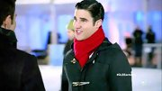Darren Criss brigthened up his toggle coat with a festive red scarf on 'Glee.'