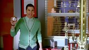 Darren Criss paired a mint green cardigan over a gingham button down for a bright and cheerful look on 'Glee.'