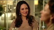 Madeleine Stowe wore her dark locks with loose curls at the ends.