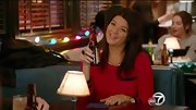 Casey Wilson's red sweater stands out thanks to its of-the-moment black trim.