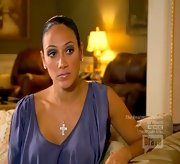 Melissa Gorga kept things feminine with a silky asymmetric blouse.