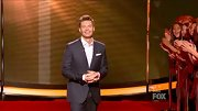 Ryan Seacrest looked dapper sans tie in this classic dark gray suit.