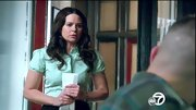 A mint green button-down shirt added some feminine fun to Katie Lowes' work look on 'Scandal.'
