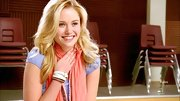 Ginny Gardner chose a peach scarf to complement her lavender top on 'Glee.'