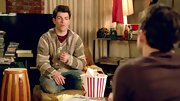 Max Greenfield let his inner reggae style show with this striped pullover sweater.