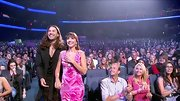 'American Idol' alum Diana DeGarmo (who famously only wore pink and black during her stint on the show) was proposed to on stage in a swirly hot pink number with crystal embellishments.