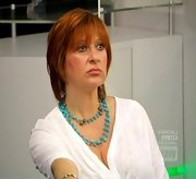 A beaded turquoise necklace dressed up Caroline Manzo's slouchy white top.