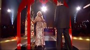 Christina Aguilera was a blond bombshell in a gold sequined floor length gown. Very va va voom!