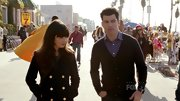 You've got to love a man who can work a cardigan like Max Greenfield.