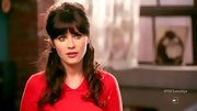 Zooey Deschanel's teased and curled half up 'do is so very Brigitte Bardot.