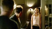 Claire Holt was thinking pink on 'Vampire Diaries' in this trendy high-low top.