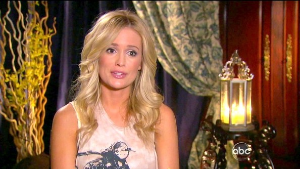 Emily Maynard adds polish to a casual look with big blond curls.