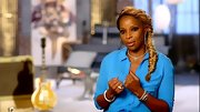 Mary J. Blige looked ultra-chic in a silky aqua blouse and flashy silver jewelry.