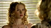It's hard to take Claudia Lee's icy stare serious with such perfectly bouncy curls.